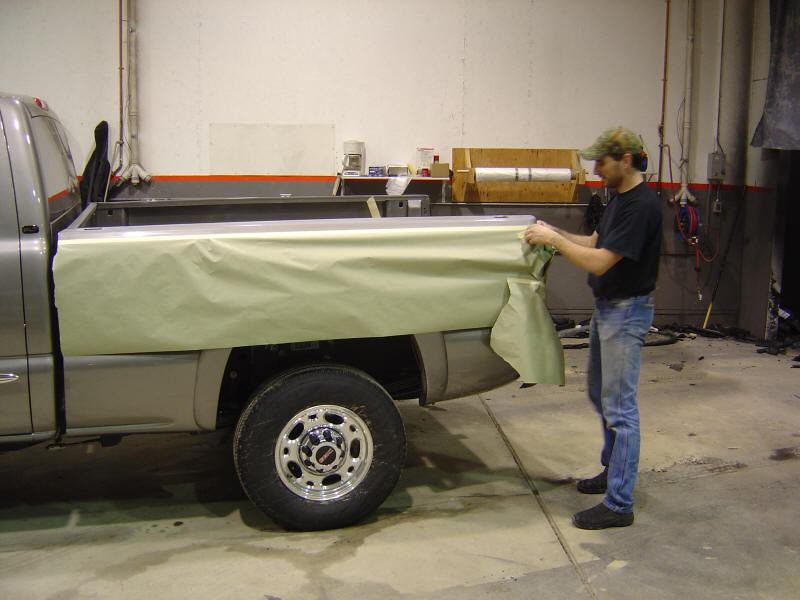 Preparation is one of the key elements to making a good bed liner or coating. We train our dealers so they will have all the skills necessary to give you the best looking and most durable product available. In the above photo the truck has already been cleaned with acetone to remove any waxes or contamination that might be on the surface. The masking process begins. They will mask any area not to be coated, this will eliminate any possibility of over spray problems. The masking process also determines where the finished edges of the bed liner will be located. The cleaner the masking job the nicer the edges will be. So most guys take a little extra time to make sure everything lines up and is in its proper place.